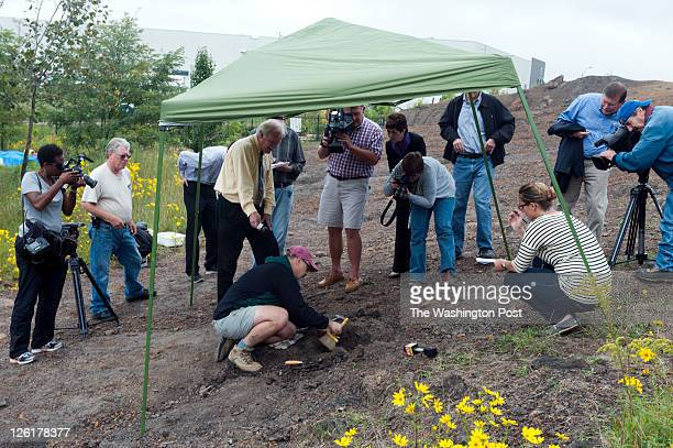 Steve Jabo fossil preparator for the Smithsonian surrounded by members of the media at the dig site at Dinosaur Park in Laurel Maryland on September...