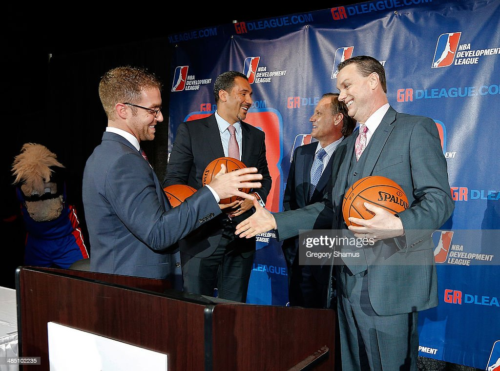 Steve Jbara NBA-D League ownership group in Grand Rapids, Dan Reed, NBA D-League president, Dennis Mannion, CEO of Palace Sports and Entertainment and the Detroit Pistons, Doug Small from Experience Grand Rapids talk after a press conference to announce a NBA Developmental League franchise relocating to Grand Rapids, Michigan on April 14, 2014 at the DeltaPlex Arena in Grand Rapids, Michigan.