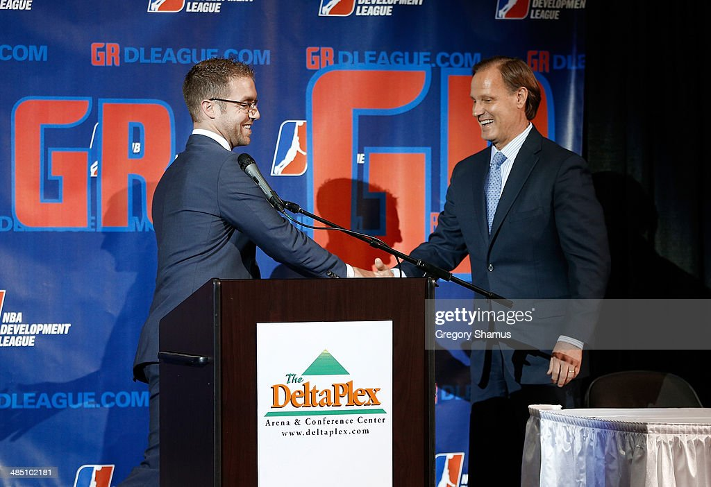 Steve Jbara of the ownership group in Grand Rapids shakes hands with Dennis Mannion the CEO of Palace Sports and Entertainment and the Detroit Pistons during a press conference to announce a NBA Developmental League franchise relocating to Grand Rapids, Michigan on April 14, 2014 at the DeltaPlex Arena in Grand Rapids, Michigan.