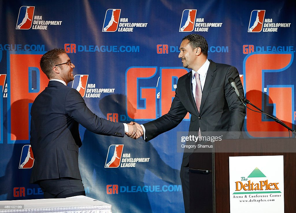 Steve Jbara of the ownership group in Grand Rapids shakes hands with NBA D-League President Dan Reed during a press conference to announce a NBA Developmental League franchise relocating to Grand Rapids, Michigan on April 14, 2014 at the DeltaPlex Arena in Grand Rapids, Michigan.