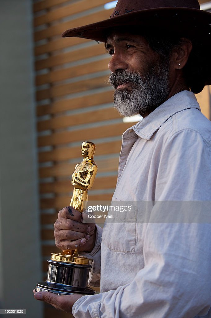 Steve Jimenez poses with an Oscar trophey during First-Ever Oscar Roadtrip at the Angelika Film Center on February 18, 2013 in Dallas.