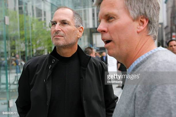 Steve Jobs Apple Computer Inc chief executive officer left and Ronald Johnson senior vice president of retail for Apple Computer Inc stand outside...