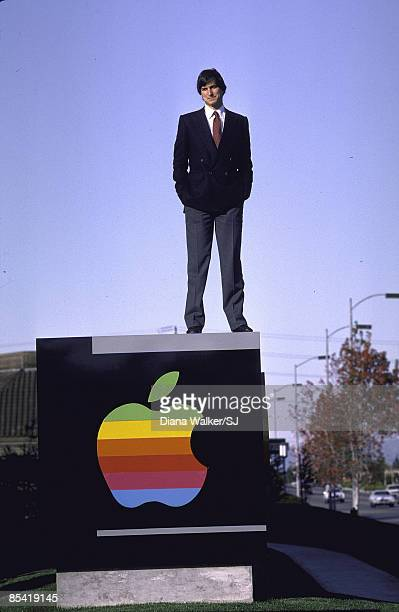 Steve Jobs atop Company sign outside Apple Computer Co in Cupertino CA December 1982 IMAGE PREVIOUSLY A TIME LIFE IMAGE