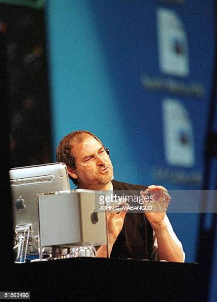 Steve Jobs CEO of Apple Computer demonstrates Apple's next operating system Mac OS X while using the new Apple Cube computer during his keynote...