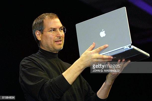 Steve Jobs CEO of Apple Computer unveils a new titanium G4 Powerbook with a 152 inch screen during his keynote address at the MacWorld Expo in San...
