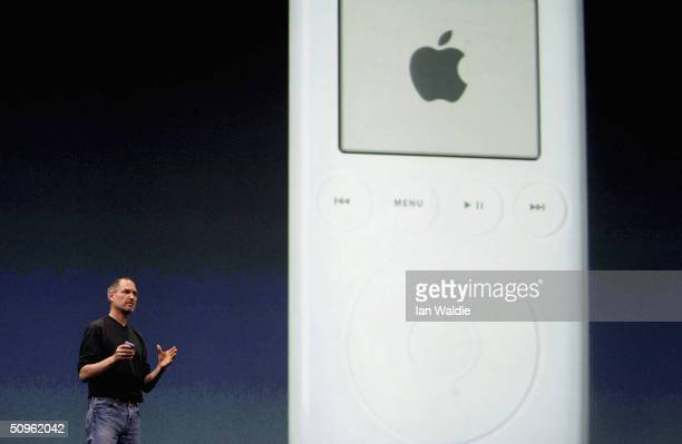 Steve Jobs Chief Executive Officer of Apple computers stands by a projection of an iPod as he launches iTunes Music Store in the territories of Great...