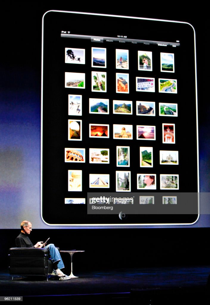 <a gi-track='captionPersonalityLinkClicked' href=/galleries/search?phrase=Steve+Jobs&family=editorial&specificpeople=204493 ng-click='$event.stopPropagation()'>Steve Jobs</a>, chief executive officer of Apple Inc., demonstrates the Apple iPad tablet during its debut at the Yerba Buena Center for the Arts Theater in San Francisco, California, U.S., on Wednesday, Jan. 27, 2010. Apple Inc., trying to expand beyond the Macintosh, iPod and iPhone, introduced the iPad, a tablet computer with a touch screen. Photographer: Tony Avelar/Bloomberg via Getty Images