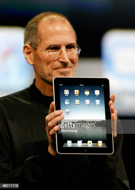 Steve Jobs chief executive officer of Apple Inc holds an Apple iPad tablet during its debut at the Yerba Buena Center for the Arts Theater in San...