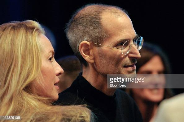 Steve Jobs chief executive officer of Apple Inc right greets members of the audience with his wife Laurene Powell Jobs after unveiling the iCloud...