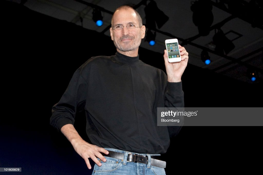 <a gi-track='captionPersonalityLinkClicked' href=/galleries/search?phrase=Steve+Jobs&family=editorial&specificpeople=204493 ng-click='$event.stopPropagation()'>Steve Jobs</a>, chief executive officer of Apple Inc., unveils the iPhone 4 during his keynote address at the Apple Worldwide Developers Conference (WWDC) in San Francisco, California, U.S., on Monday, June 7, 2010. Jobs introduced the redesigned iPhone 4 today, delivering a 24 percent thinner body and 100 new features as mobile competitors including Google Inc. work to usurp the smartphone's popularity. Photographer: David Paul Morris/Bloomberg via Getty Images