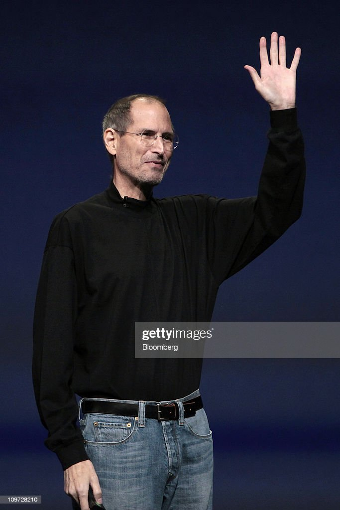 <a gi-track='captionPersonalityLinkClicked' href=/galleries/search?phrase=Steve+Jobs&family=editorial&specificpeople=204493 ng-click='$event.stopPropagation()'>Steve Jobs</a>, chief executive officer of Apple Inc., waves after introducing the iPad 2 at an event in San Francisco, California, U.S., on Wednesday, March 2, 2011. Jobs, making his first public appearance since taking medical leave in January, unveiled a follow-up to a tablet computer released last April that has front and rear cameras, and a faster A5 chip. Photographer: David Paul Morris/Bloomberg via Getty Images