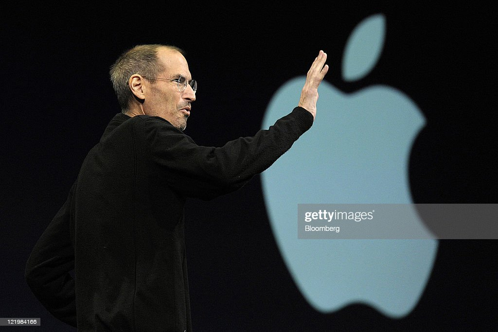 Steve Jobs, chief executive officer of Apple Inc., waves to the audience before unveiling the iCloud storage system at the Apple Worldwide Developers Conference 2011 in San Francisco, California, U.S., on Monday, June 6, 2011. Apple Inc. Chief Executive Officer Steve Jobs, who built the world's most valuable technology company, resigned. He is succeeded by Chief Operating Officer Tim Cook. Photographer: David Paul Morris/Bloomberg via Getty Images