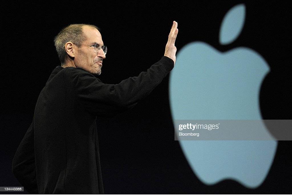 Steve Jobs, chief executive officer of Apple Inc., waves to the audience before unveiling the iCloud storage system at the Apple Worldwide Developers Conference 2011 in San Francisco, California, U.S., on Monday, June 6, 2011. Apple is using iCloud to retain its dominance in the smartphone and tablet markets amid fresh competition from devices powered by Google Inc.'s Android software. Photographer: David Paul Morris/Bloomberg via Getty Images