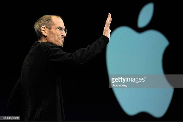 Steve Jobs chief executive officer of Apple Inc waves to the audience before unveiling the iCloud storage system at the Apple Worldwide Developers...