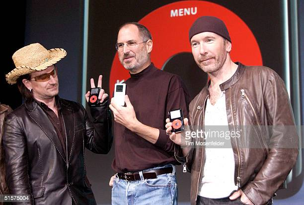 Steve Jobs of Apple Computer with Bono and The Edge of U2 celebrate the release of a new Apple iPod family of products at the California Theatre on...