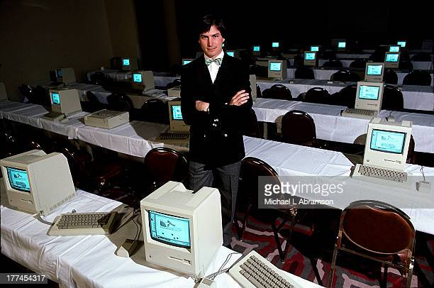 Steve Jobs with room full of computers 1984