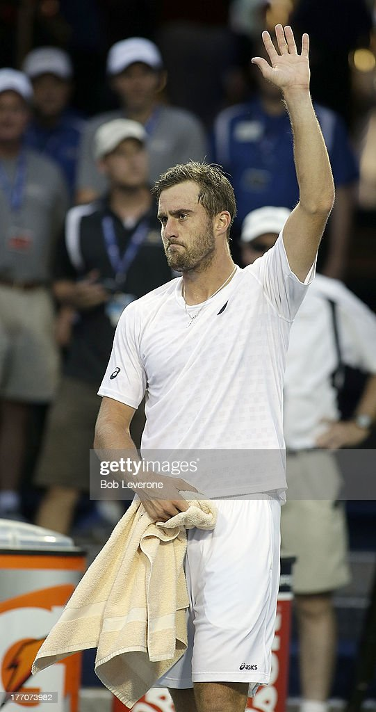 Steve Johnson acknowldeges the crowd for their support at center court after he defeated second seeded Andreas Seppi of Italy in three sets on August 20, 2013 in Winston Salem, North Carolina.