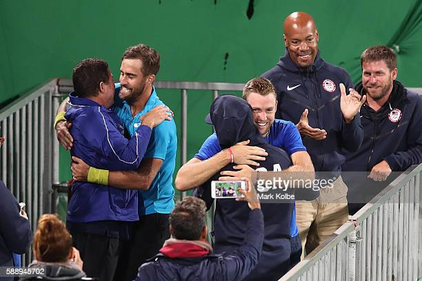 Steve Johnson and Jack Sock of the United States celebrating match point in the Men's Doubles Bronze medal match against Vasek Pospisil and Daniel...