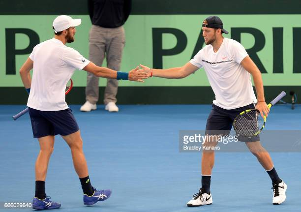 Steve Johnson and Jack Sock of the USA celebrate a point in their doubles match against John Peers and Sam Groth of Australia during the Davis Cup...