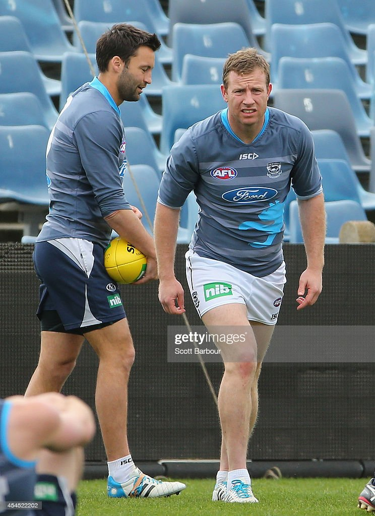 Steve Johnson and Jimmy Bartel of the Cats stretch during a Geelong Cats AFL training session at Simonds Stadium on September 3, 2014 in Geelong, Australia.