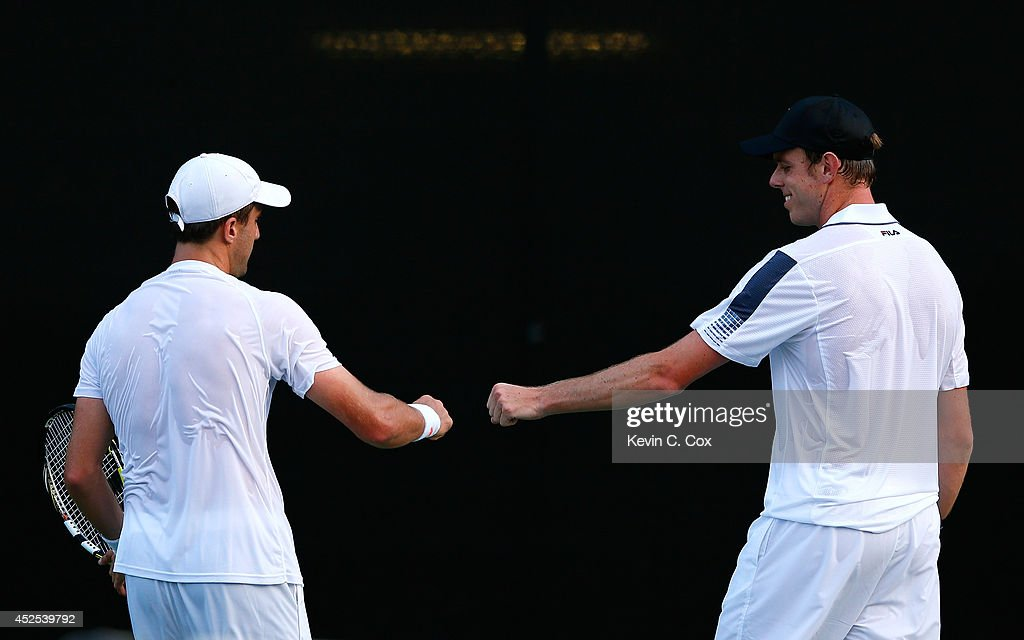 Steve Johnson and Sam Querrey react after a point against Denis Istomin of Uzbekistan and Marinko Matosevic of Australia during the BB&T Atlanta Open at Atlantic Station on July 22, 2014 in Atlanta, Georgia.