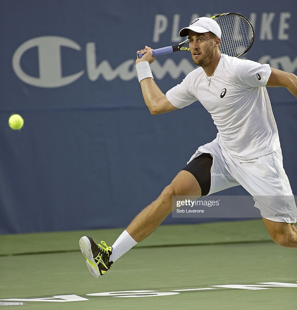 Steve Johnson chases down a return on the way to defeating second seeded Andreas Seppi of Italy in three sets on August 20, 2013 in Winston Salem, North Carolina.