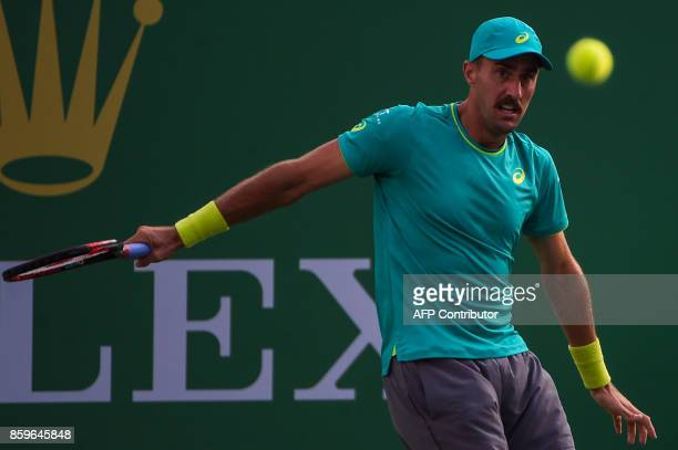 Steve Johnson of America hits a return during the men's singles against Nick Kyrgios of Australia at the Shanghai Masters tennis tournament in...