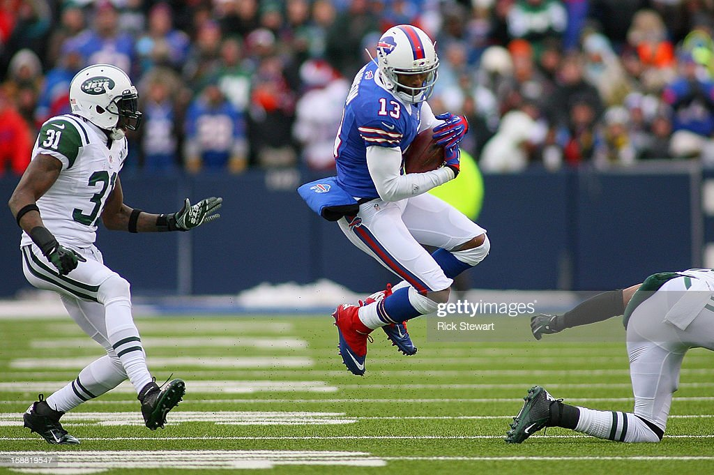 Steve Johnson #13 of the Buffalo Bills makes a catch against <a gi-track='captionPersonalityLinkClicked' href=/galleries/search?phrase=Antonio+Cromartie&family=editorial&specificpeople=583197 ng-click='$event.stopPropagation()'>Antonio Cromartie</a> #31 of the New York Jets at Ralph Wilson Stadium on December 30, 2012 in Orchard Park, New York. Buffalo defeated New York 28-9.