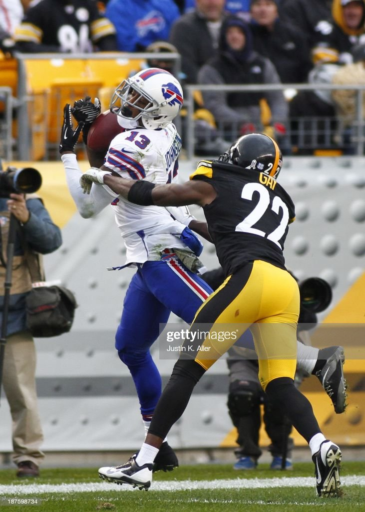 Steve Johnson #13 of the Buffalo Bills pulls in the pass against William Gay #22 of the Pittsburgh Steelers during the game on November 10, 2013 at Heinz Field in Pittsburgh, Pennsylvania.