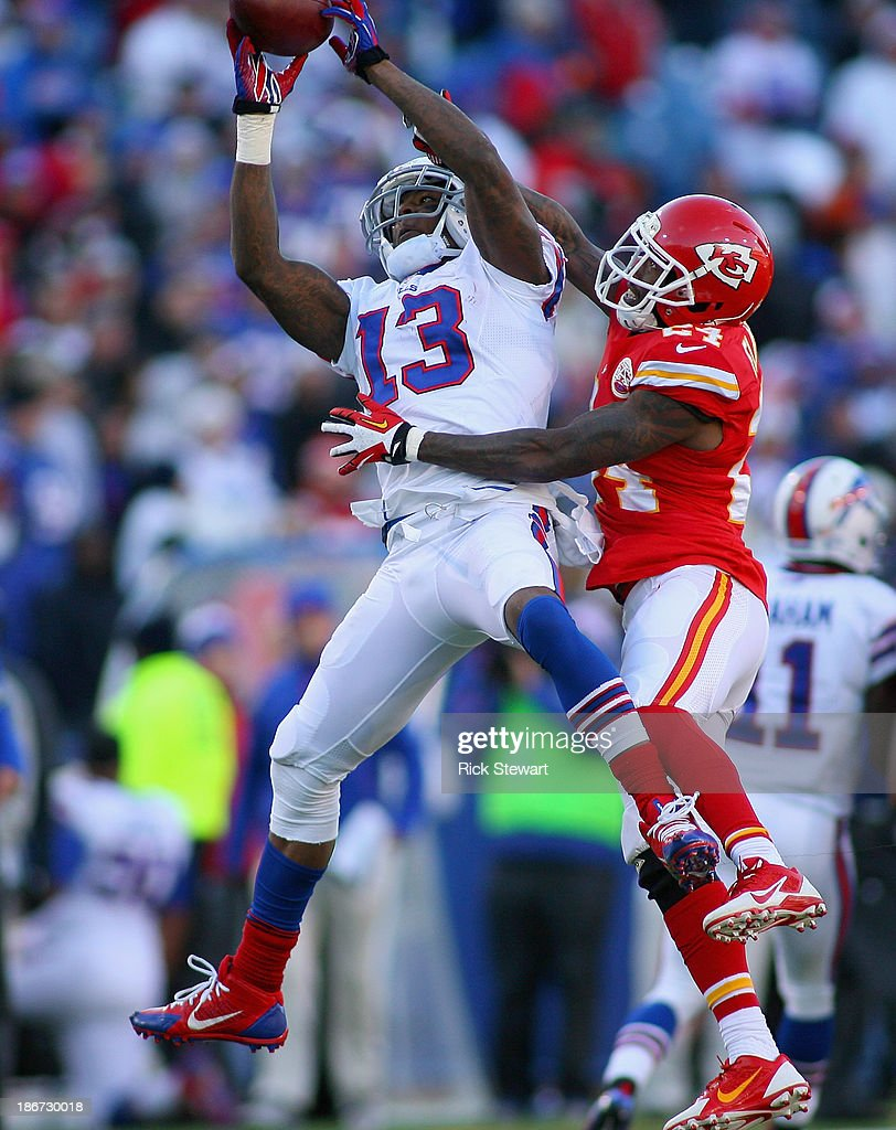 Steve Johnson #13 of the Buffalo Bills reaches for a catch against Brandon Flowers #24 of the Kansas City Chiefs at Ralph Wilson Stadium on November 3, 2013 in Orchard Park, New York. Kansas City won 23-13.