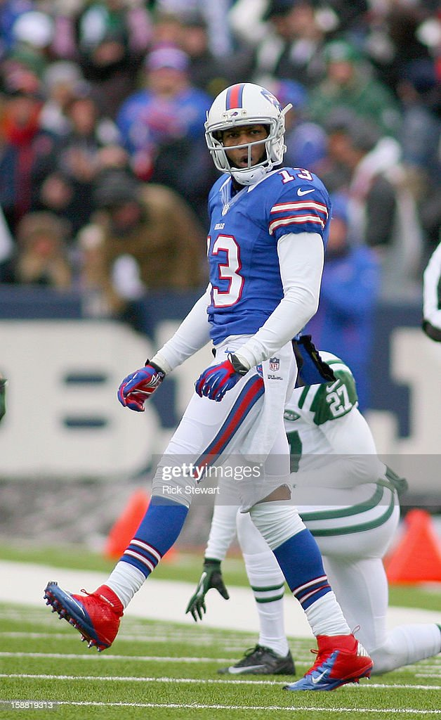 Steve Johnson #13 of the Buffalo Bills reacts after making a 37 yard catch against Darrin Walls #27 of the New York Jets at Ralph Wilson Stadium on December 30, 2012 in Orchard Park, New York. The catch put Johnson over 1000 yards receiving for the year. Buffalo won 28-9.