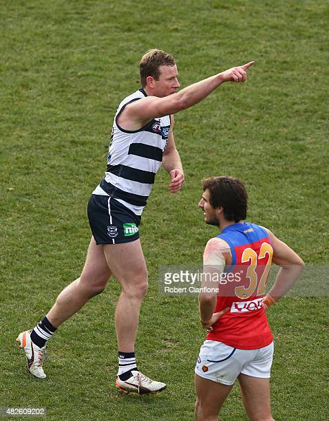 Steve Johnson of the Cats celebrates after scoring a goal during the round 18 AFL match between the Geelong Cats and the Brisbane Lions at Simonds...