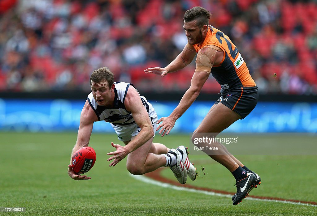 Steve Johnson of the Cats competes for the ball against Sam Reid of the Giants during the round 11 AFL match between the Greater Western Sydney Giants and the Geelong Cats at Skoda Stadium on June 8, 2013 in Sydney, Australia.
