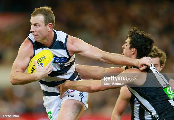 Steve Johnson of the Cats fends off the tackle of Scott Pendlebury of the Magpies during the round six AFL match between the Collingwood Magpies and...