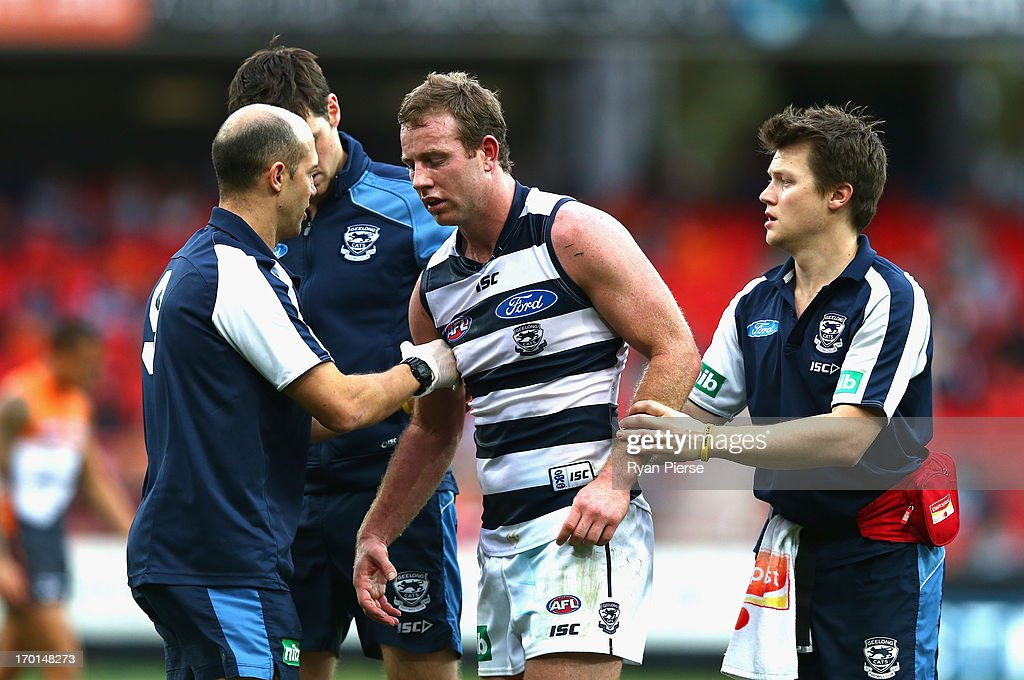 Steve Johnson of the Cats gets to his feet after clashing heads with Allen Christensen of the Cats during the round 11 AFL match between the Greater Western Sydney Giants and the Geelong Cats at Skoda Stadium on June 8, 2013 in Sydney, Australia.