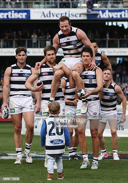 Steve Johnson of the Cats reacting to the sight of his son walking to him is carried off after playing his last game for the club by Tom Lonergan and...