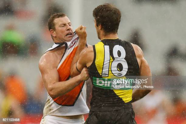 Steve Johnson of the Giants and Alex Rance of the Tigers clash during the 2017 AFL round 18 match between the Richmond Tigers and the GWS Giants at...