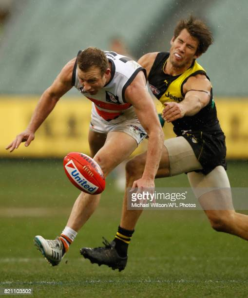 Steve Johnson of the Giants and Alex Rance of the Tigers compete for the ball during the 2017 AFL round 18 match between the Richmond Tigers and the...