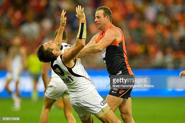 Steve Johnson of the Giants and Luke Hodge of the Hawks wrestle during the round six AFL match between the Greater Western Sydney Giants and the...