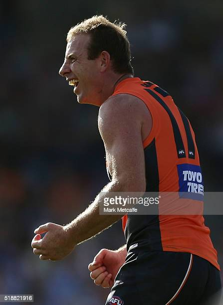 Steve Johnson of the Giants celebrates a goal kicked by a team mate during the round two AFL match between the Greater Western Sydney Giants and the...