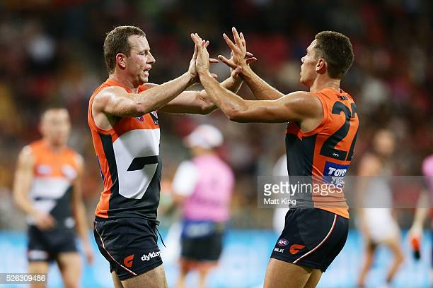 Steve Johnson of the Giants celebrates with Josh Kelly of the Giants after kicking a goal during the round six AFL match between the Greater Western...