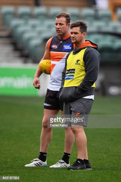 Steve Johnson of the Giants chatrs with a trainer during a Greater Western Sydney Giants AFL training session at Adelaide Oval on September 6 2017 in...