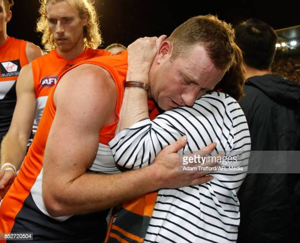 Steve Johnson of the Giants hugs family after his final game during the 2017 AFL Second Preliminary Final match between the Richmond Tigers and the...