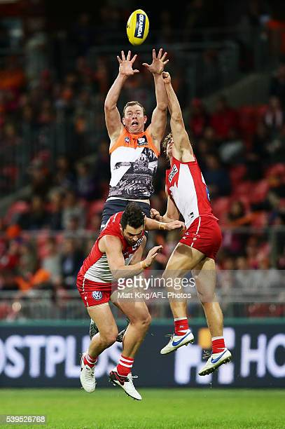 Steve Johnson of the Giants is challenged by Heath Grundy and Dane Rampe of the Swans during the round 12 AFL match between the Greater Western...