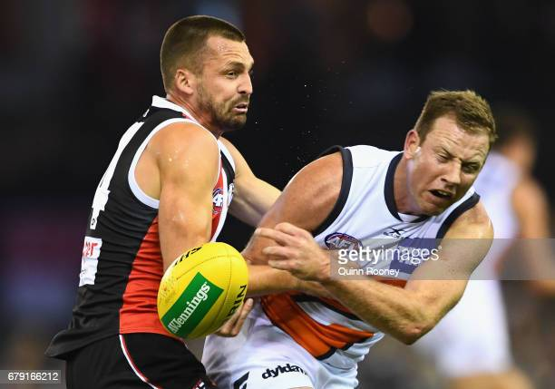 Steve Johnson of the Giants is tackled by Jarryn Geary of the Saints during the round seven AFL match between the St Kilda Saints and the Greater...