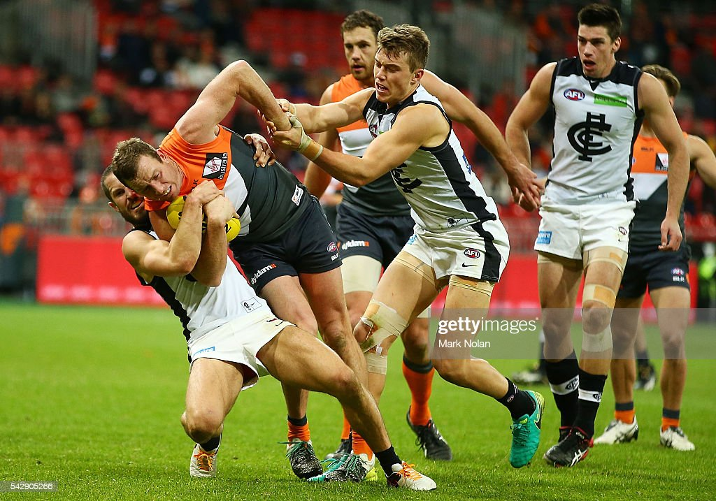 <a gi-track='captionPersonalityLinkClicked' href=/galleries/search?phrase=Steve+Johnson+-+Australian+Rules+Footballer&family=editorial&specificpeople=11430122 ng-click='$event.stopPropagation()'>Steve Johnson</a> of the Giants is tackled during the round 14 AFL match between the Greater Western Sydney Giants and the Carlton Blues at Spotless Stadium on June 25, 2016 in Sydney, Australia.