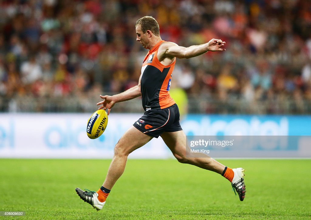 <a gi-track='captionPersonalityLinkClicked' href=/galleries/search?phrase=Steve+Johnson+-+Australian+Rules+Footballer&family=editorial&specificpeople=11430122 ng-click='$event.stopPropagation()'>Steve Johnson</a> of the Giants kicks a goal during the round six AFL match between the Greater Western Sydney Giants and the Hawthorn Hawks at Spotless Stadium on April 30, 2016 in Sydney, Australia.