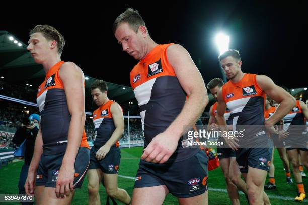 Steve Johnson of the Giants looks dejected after defeat with Lachie Whitfield of the Giants during the round 23 AFL match between the Geelong Cats...