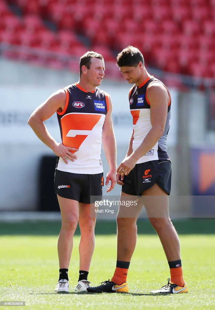 Steve Johnson of the Giants (L) talks to Jonathon Patton of the Giants (R) during the Greater Western Sydney Giants AFL training session at Spotless Stadium on September 13, 2017 in Sydney, Australia.