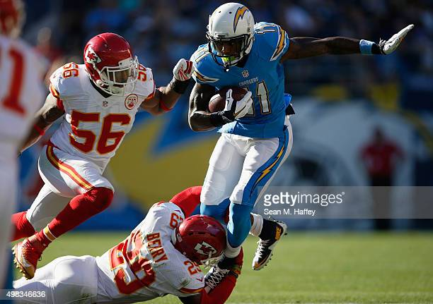 Steve Johnson of the San Diego Chargers runs with the ball turnover avoid the tackle of Eric Berry of the Kansas City Chiefs and Derrick Johnson of...